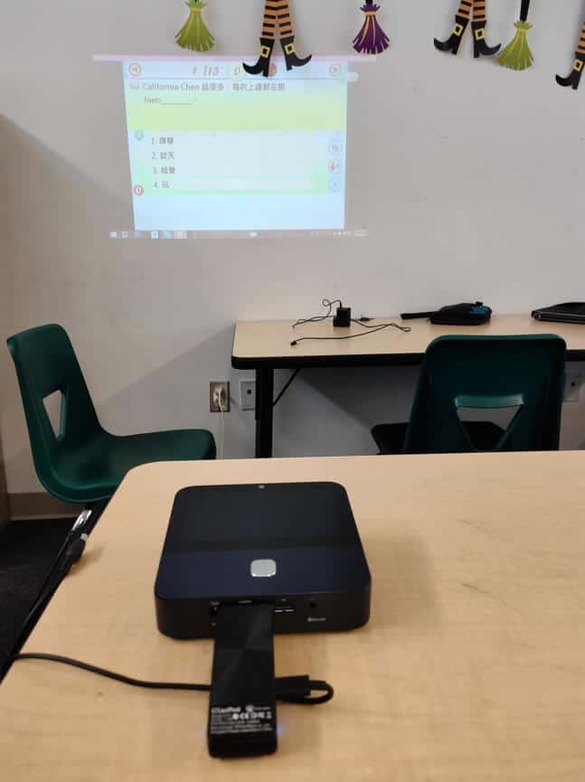 EZCast Pro II dongle on projector